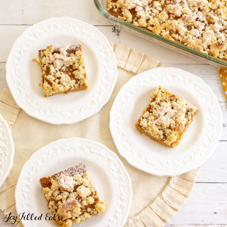 keto pumpkin bars on small plates and in a glass baking dish