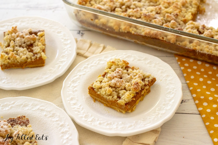 keto pumpkin bars on plates and in the baking dish