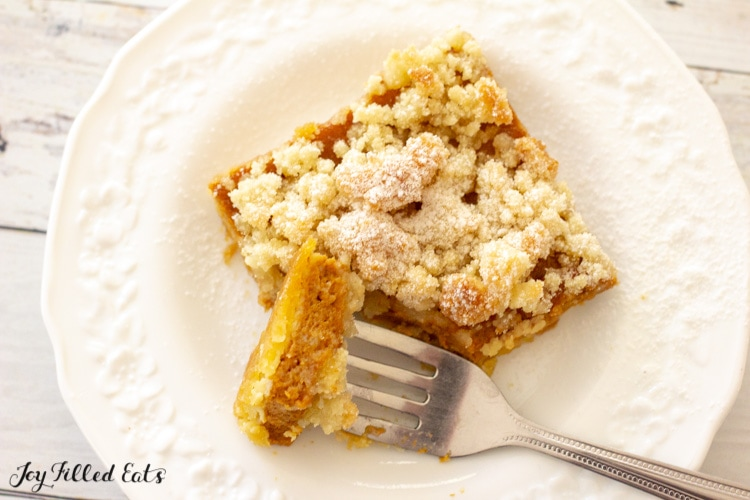 a bite of one of the pumpkin crumb bars on a fork on a plate