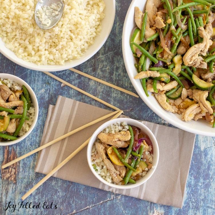 bowls of keto stir fry and cauliflower rice