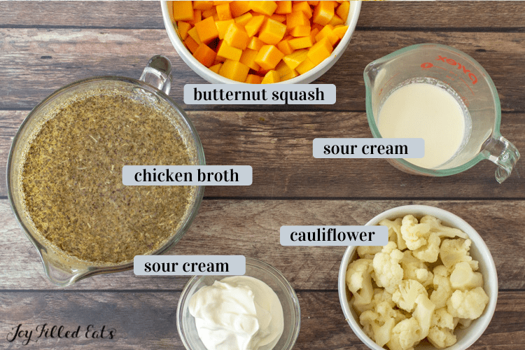 small bowls of ingredients including broth, sour cream, and heavy cream