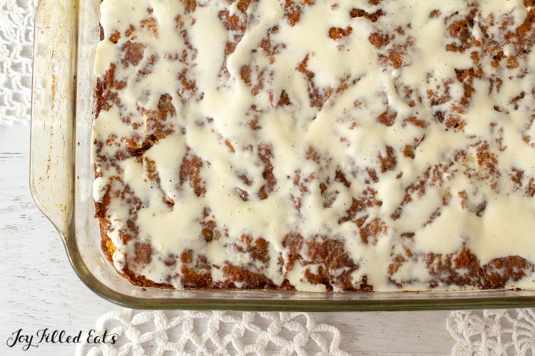 close up of the pan with low carb cinnamon roll cake with cream cheese glaze in the pan
