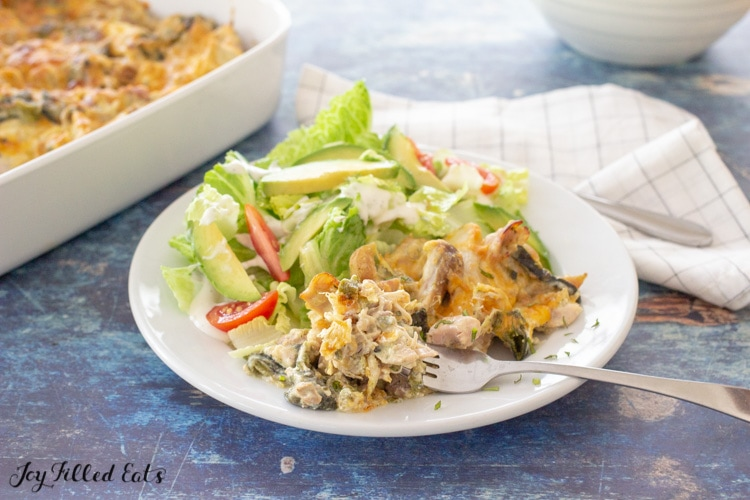 keto chicken and chile relleno casserole on a plate with salad