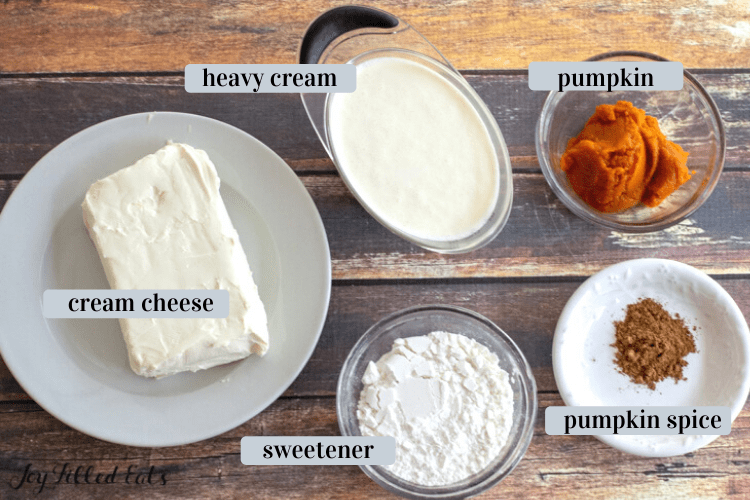 ingredients in small bowls including heavy cream, whipped cream, spices, and sweetener