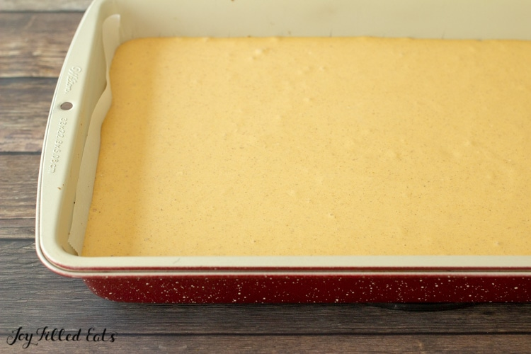 pumpkin cheesecake filling in a parchment lined baking pan
