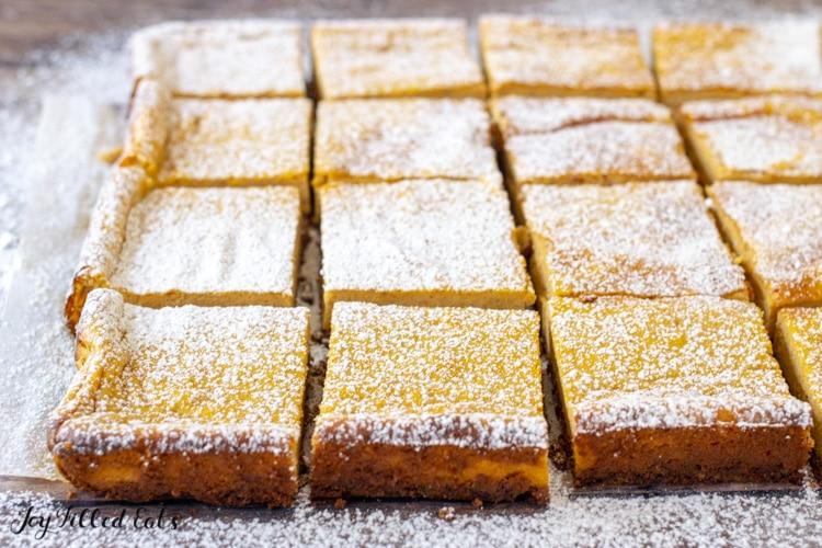 keto pumpkin cheesecake bars sprinkled with powdered sweetener