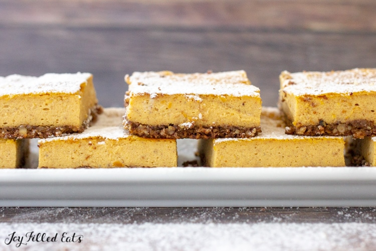 a plate with low carb pumpkin cheesecake bars