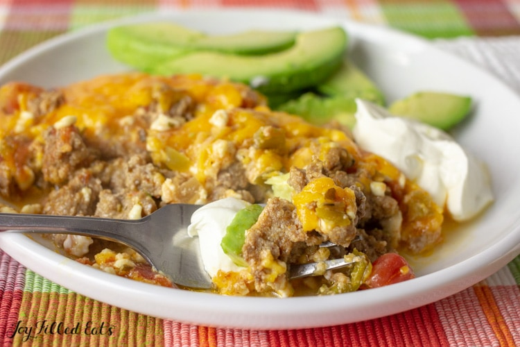 a fork scooping some of the taco casserole