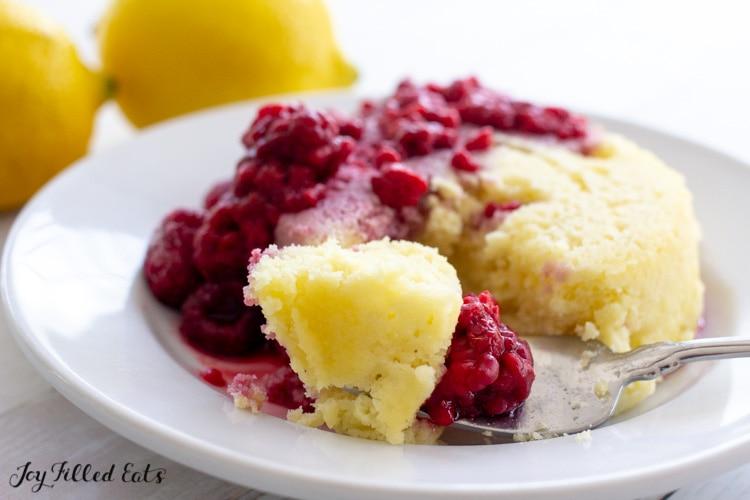 close up of a bite of keto lemon mug cake with raspberries
