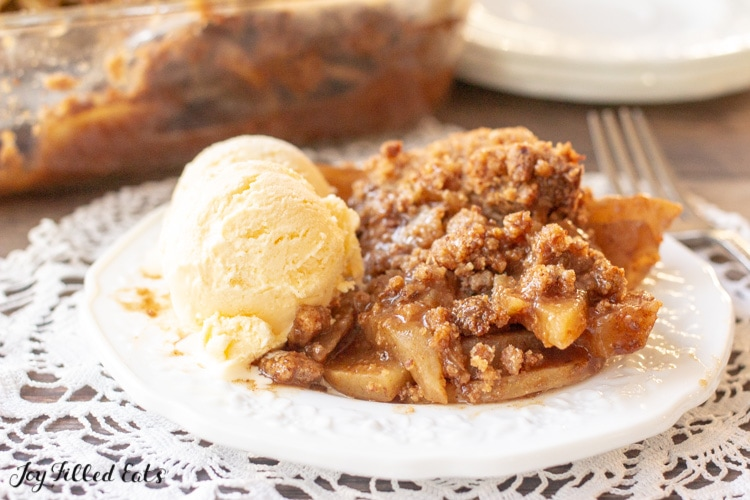 a plate on a doily with low carb apple crisp and a fork