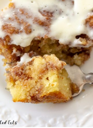 close up of a bite of cinnamon cake on a fork