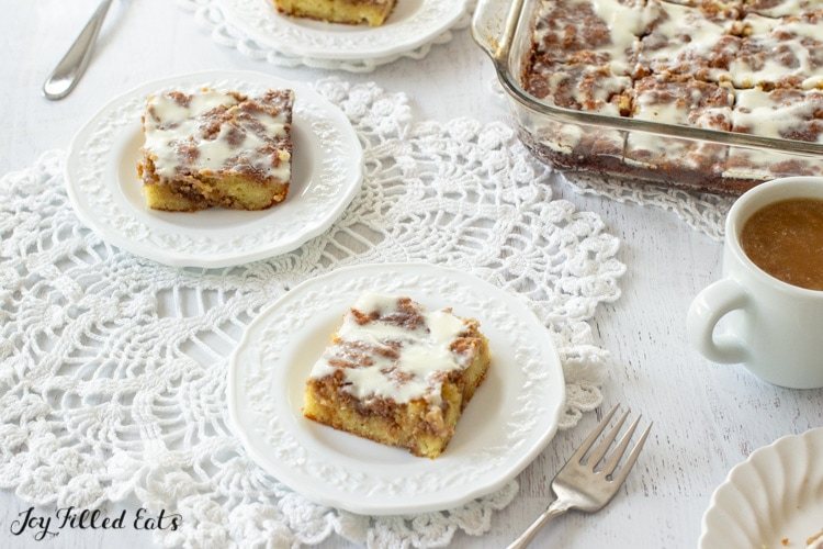 pieces of low carb cinnamon roll cake on small white plates