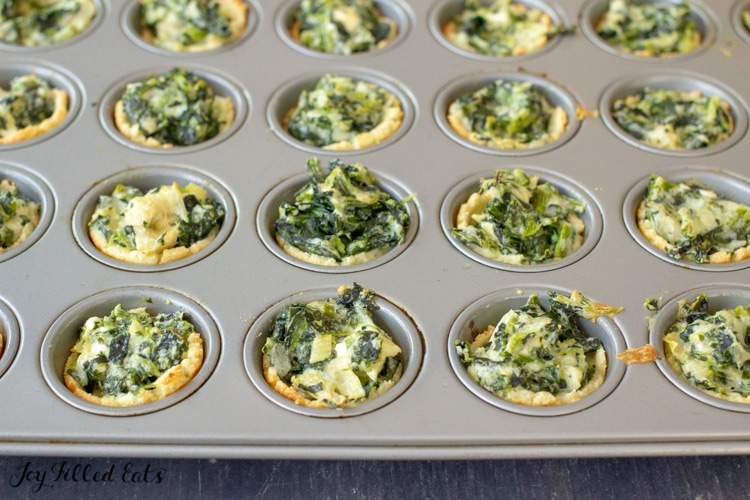baked keto spinach artichoke dip bites in a mini muffin tin