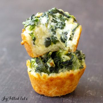 one whole keto spinach artichoke dip bite under a second one with a bite missing