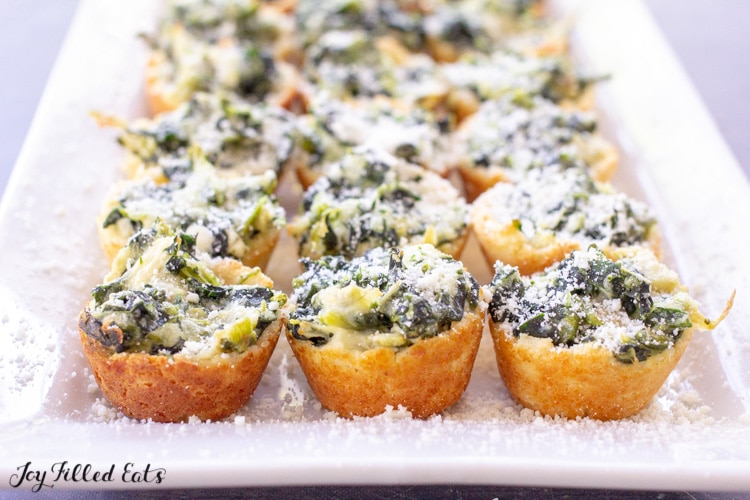 side view of a platter with keto spinach artichoke dip bites