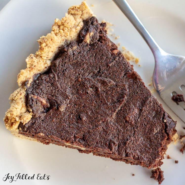 a piece of keto chocolate tart on a plate