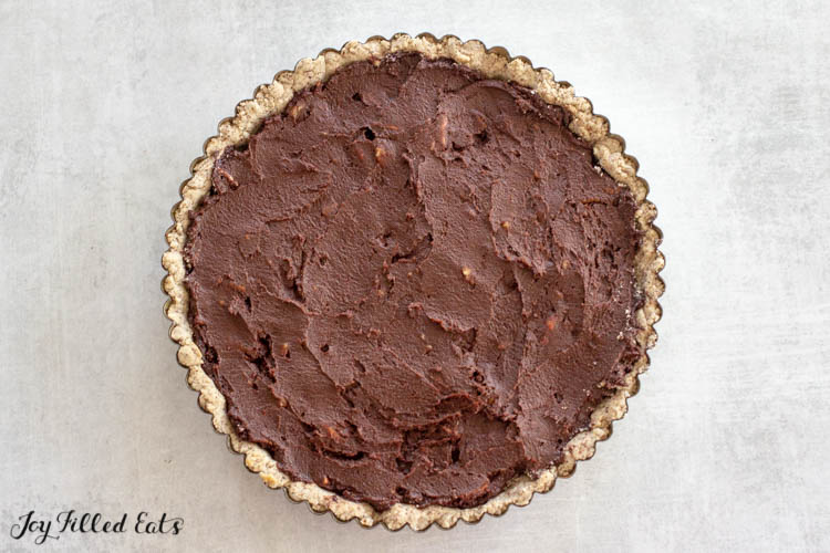 chocolate batter in the tart shell