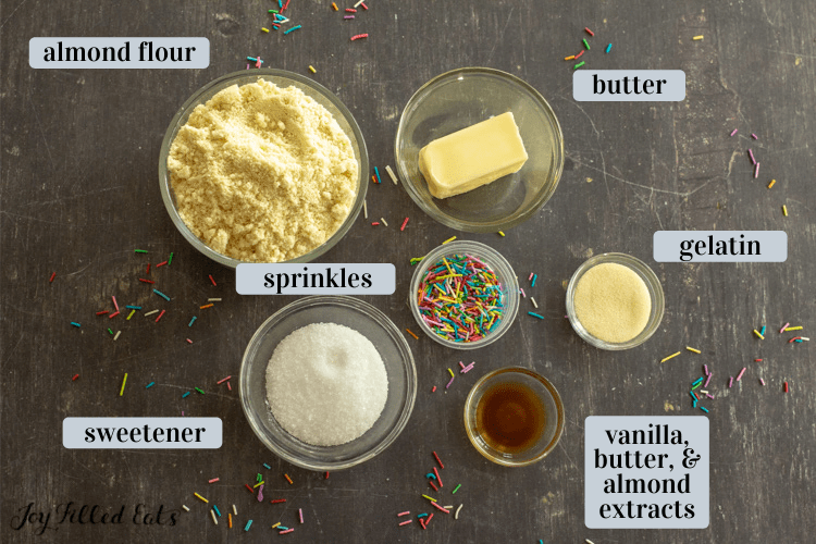ingredients in small bowls including almond flour, sweetener, and butter