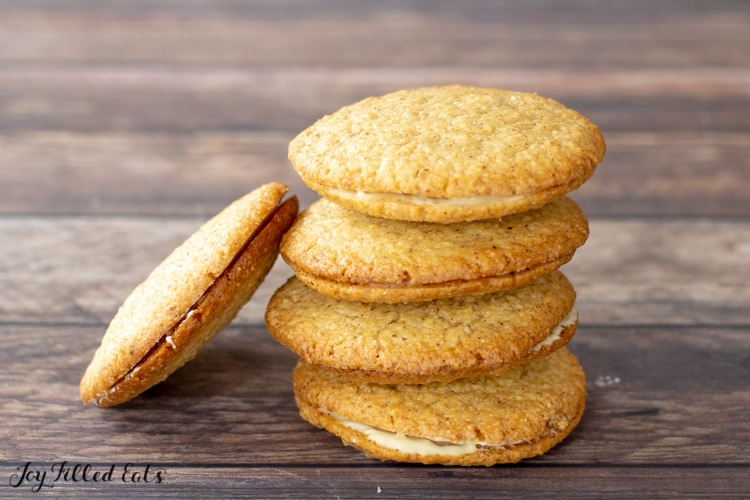 stack of almond butter cookies with one leaning against the stack
