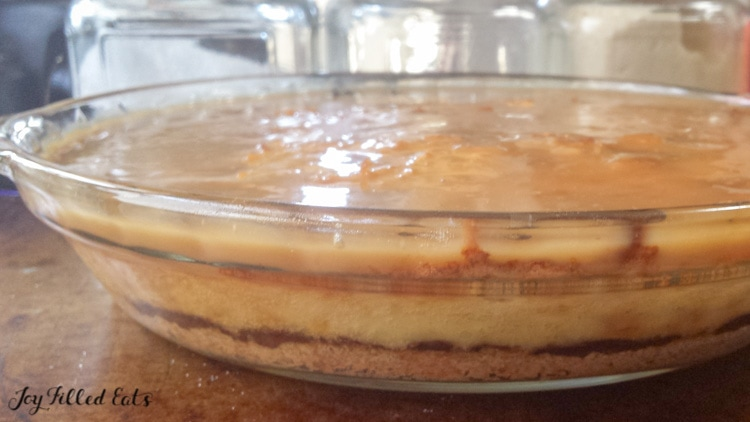 layers of caramel and chocolate with the keto coconut cream pie