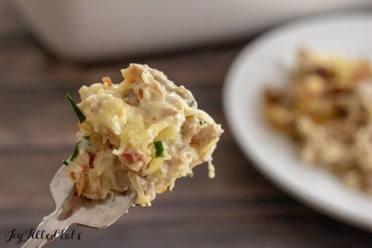 fork holding up a bite of the keto creamy chicken casserole