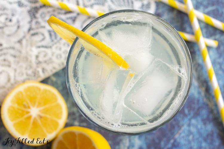 overhead shot of glass with ice and lemon