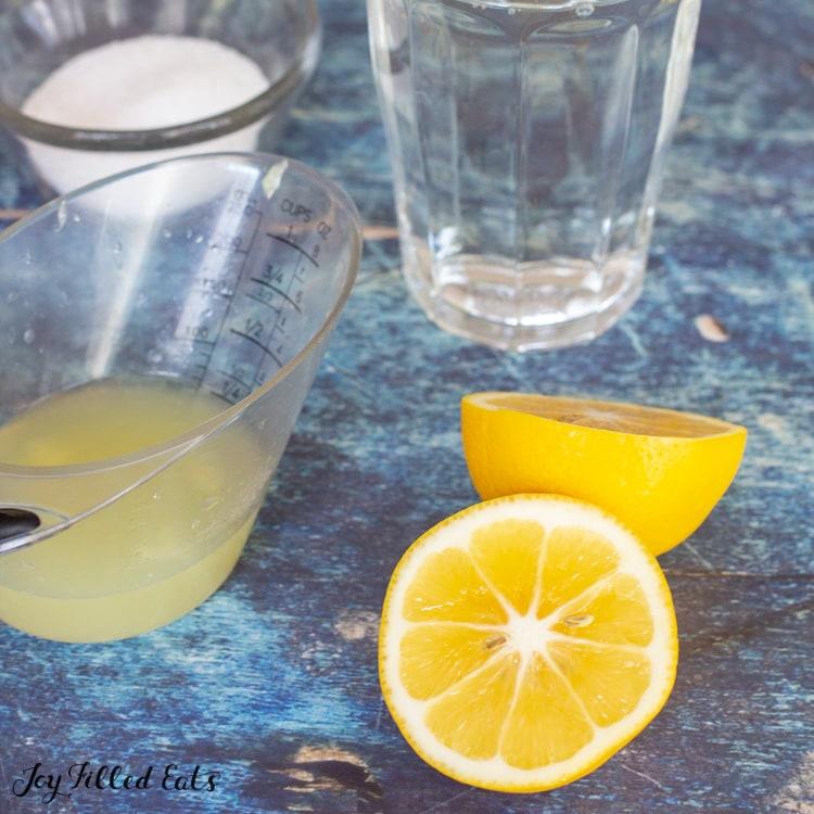 measuring cup of lemon juice