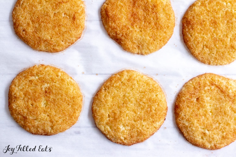 baked keto snickerdoodles on parchment paper