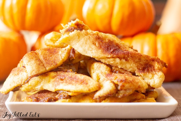a small dish with keto pumpkin twists and a pumpkin background