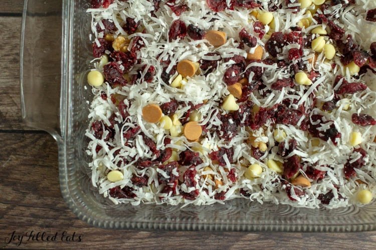 the toppings on the crust in a baking pan