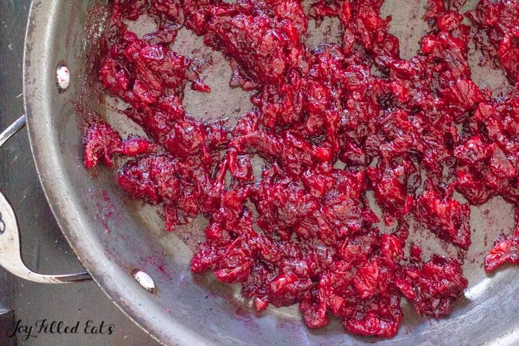 the berries cooking down in skillet