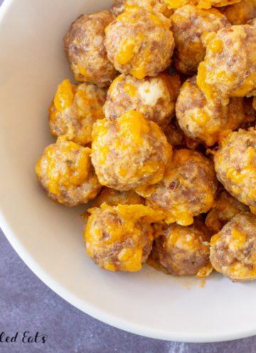 keto sausage balls in a white serving bowl