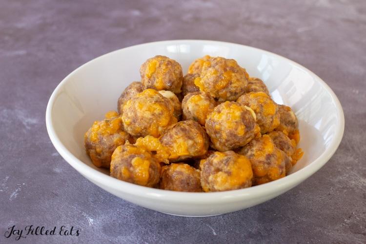 a white bowl of keto sausage balls