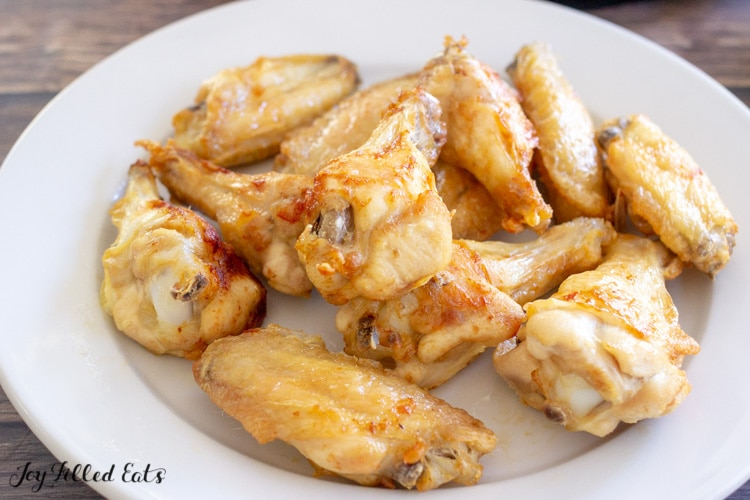white plate with oven baked chicken wings