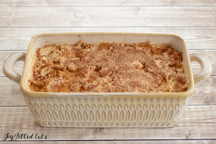 batter with cinnamon in a loaf pan