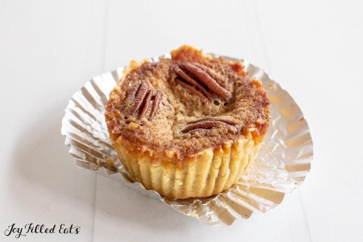low carb pecan pie tart on an aluminum cupcake wrapper