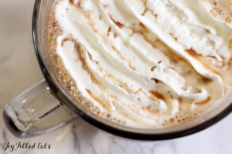 close up of sugar free hot chocolate topped with whipped cream