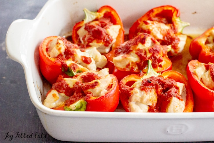 pepper halves with chicken and sauce