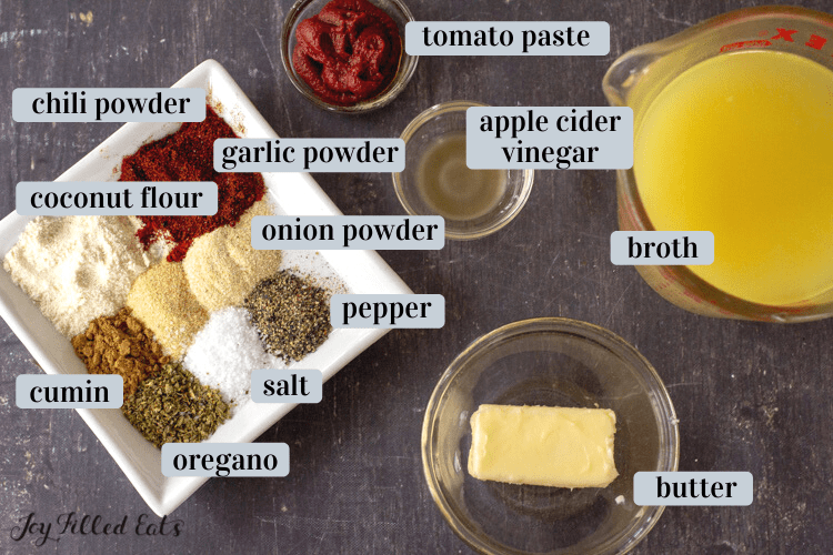 ingredients in small bowls including butter and spices