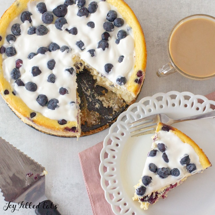 overhead shot of the keto blueberry cheesecake with a piece on a small plate