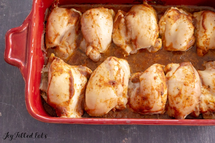 baked chicken thighs in a casserole dish