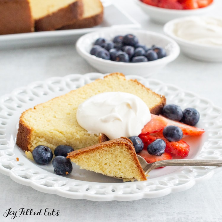 a slice of pound cake topped with whipped cream and berries