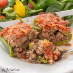 close up of one of the paleo stuffed peppers with a biet on a fork