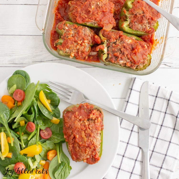 overhead shot of Paleo Stuffed Peppers in a glass baking dish and on a plate