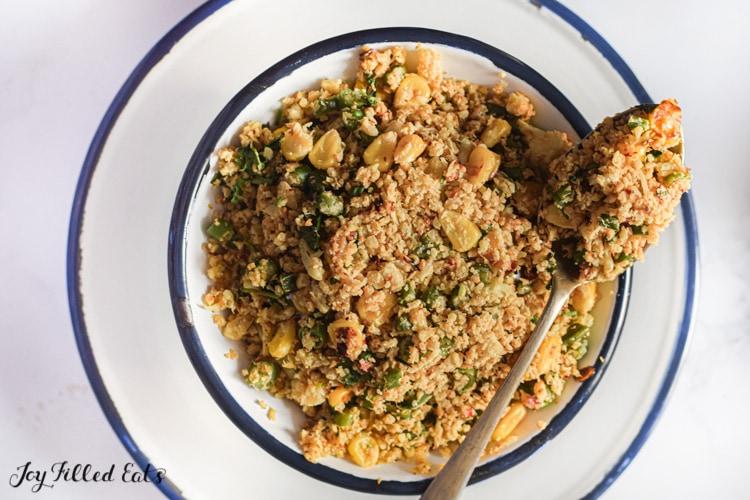 overhead shot of a bowl of mediterranean cauliflower rice