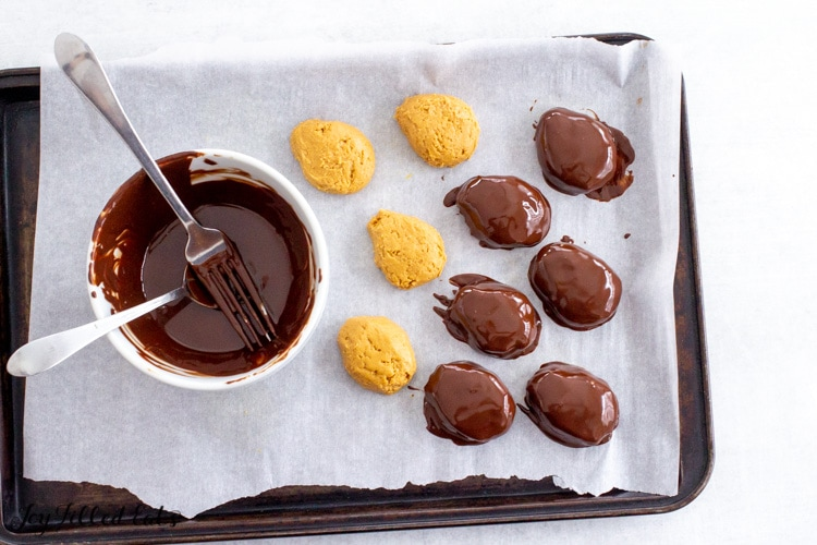 bowl of melted chocolate with spoon and fork