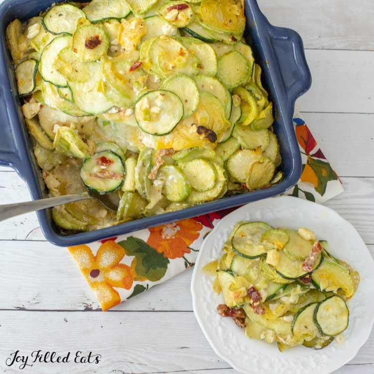 overhead shot of zucchini casserole with a serving on a plate