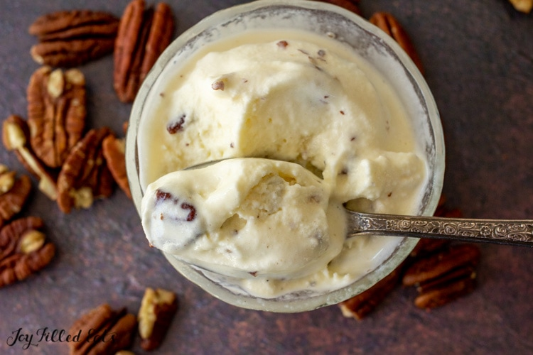 spoon in a bowl of butter pecan ice cream