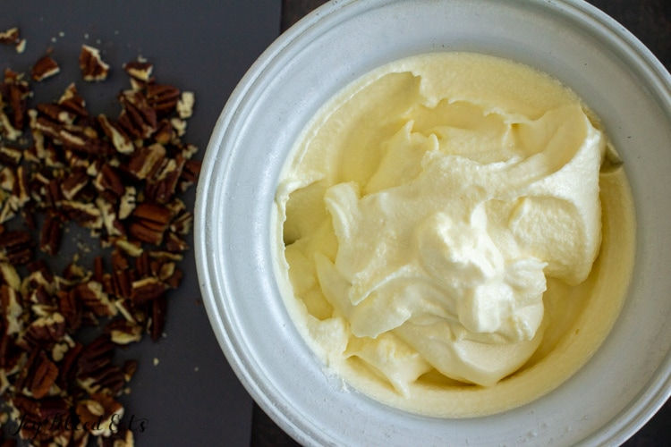 freezer bowl with churned keto butter pecan ice cream