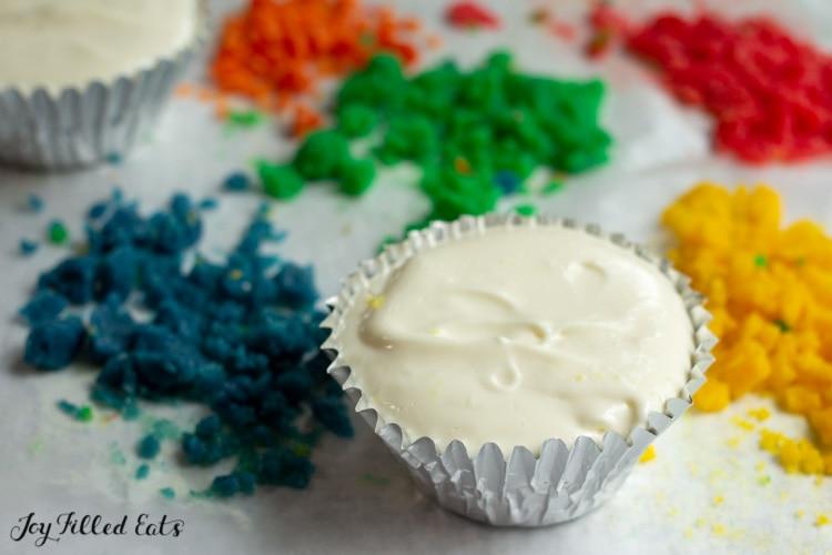 mini cheesecake next to piles of homemade sprinkles